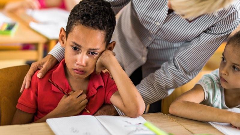 Image of upset school students.