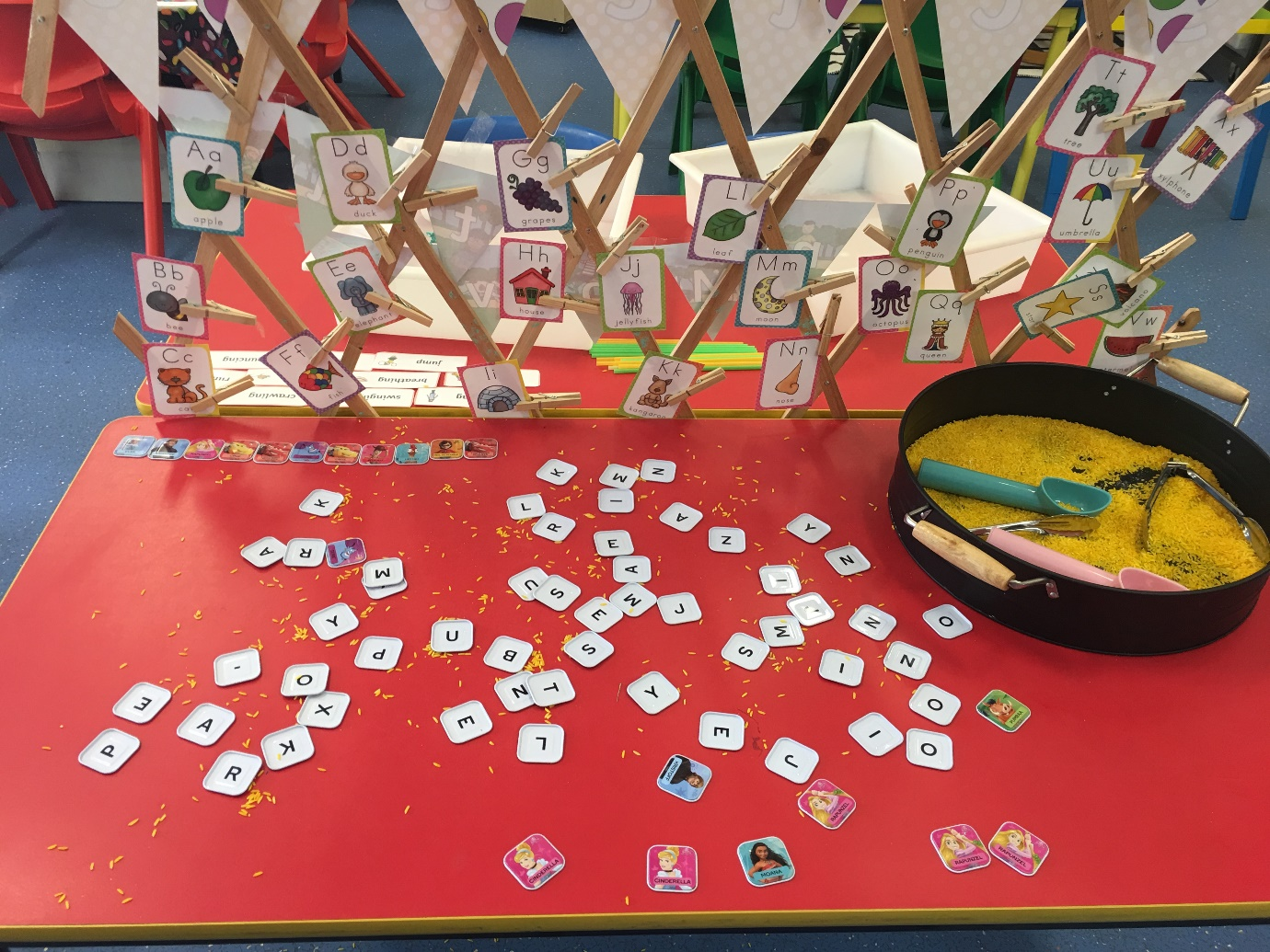 Colourful table with cards and learning resources for fun phonics activity
