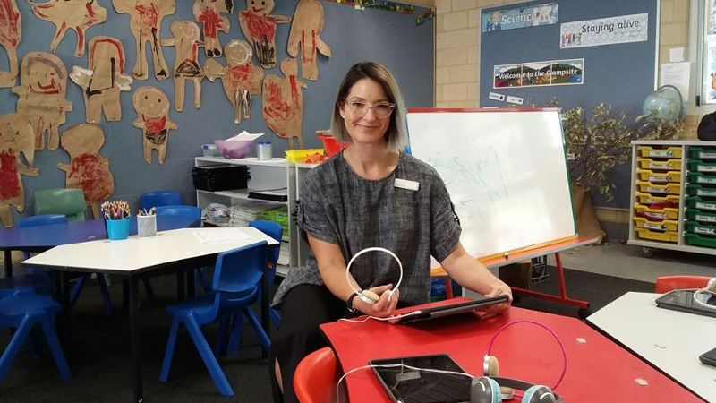 A education support worker shown doing their placement in a school setting.