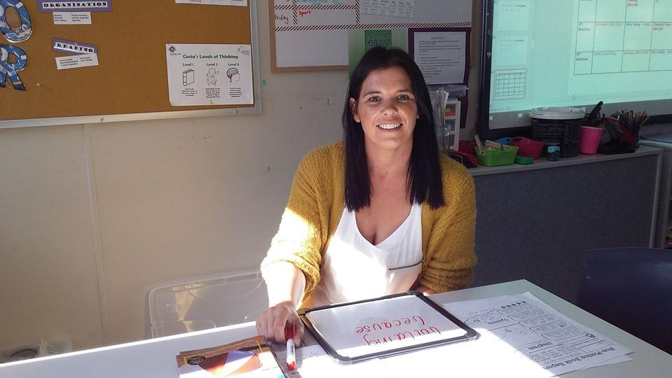 Teacher aide working in a school classroom.