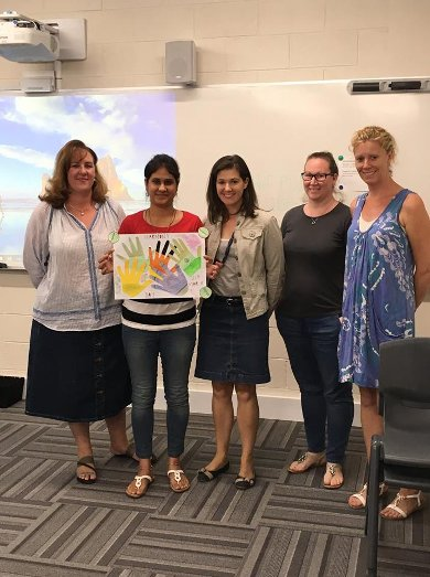 5 adult female students showing example of resources made for children