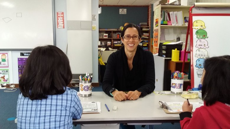 female teacher aide in a class with 2 students