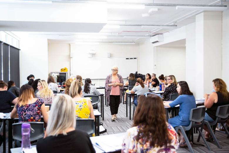 Classroom of adults with trainer learning teaching skills