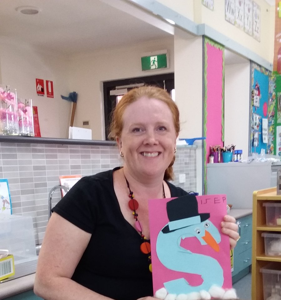 Female SSO with a4 size page with letter s used as part of an activity for reading and writing development.