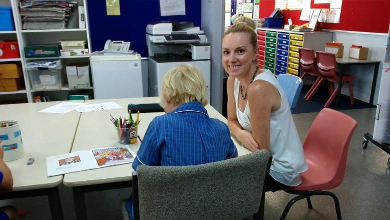 Picture of a teacher aide from ITAC doing her 100-hour placement in a school.