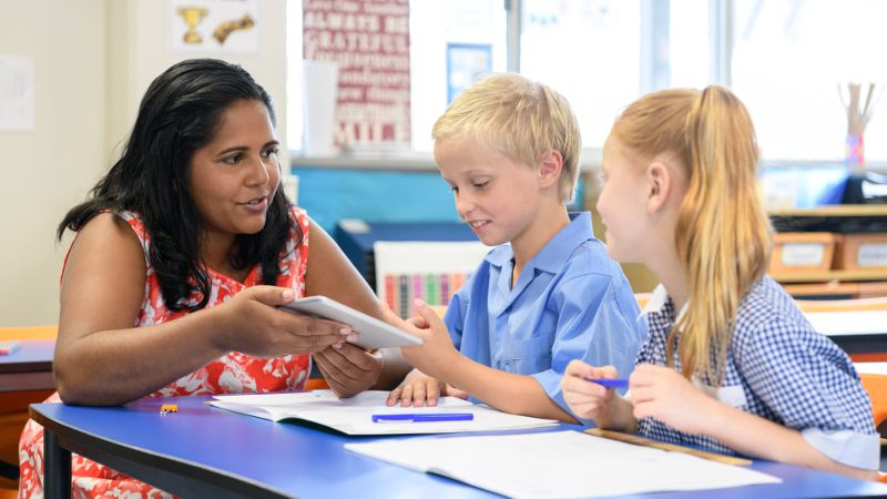 Experienced teacher assistant rapport building with students.