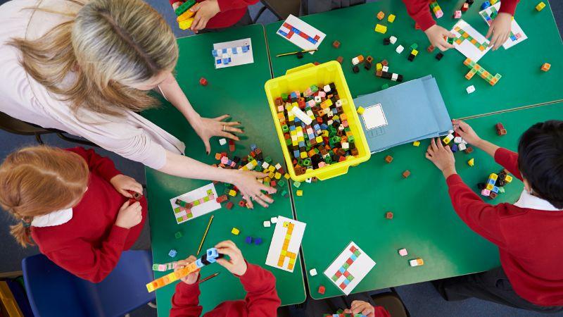 Classroom activity involving small blocks.