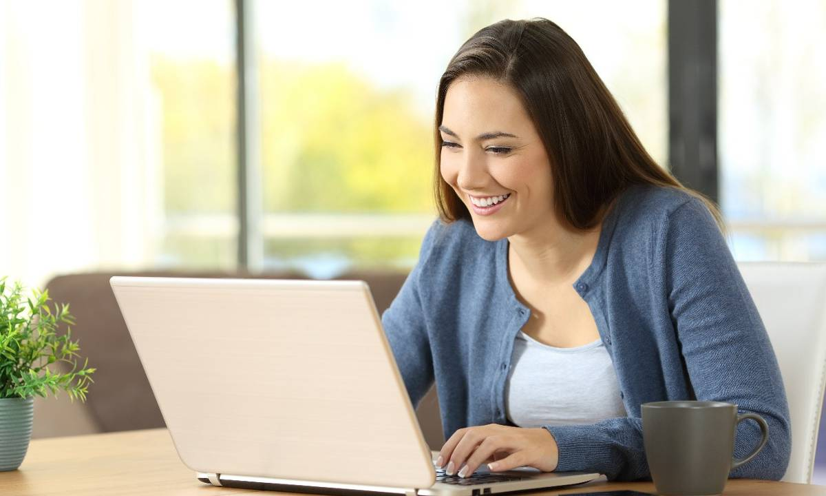 Adult learner studying to become a teacher aide via distance learning.