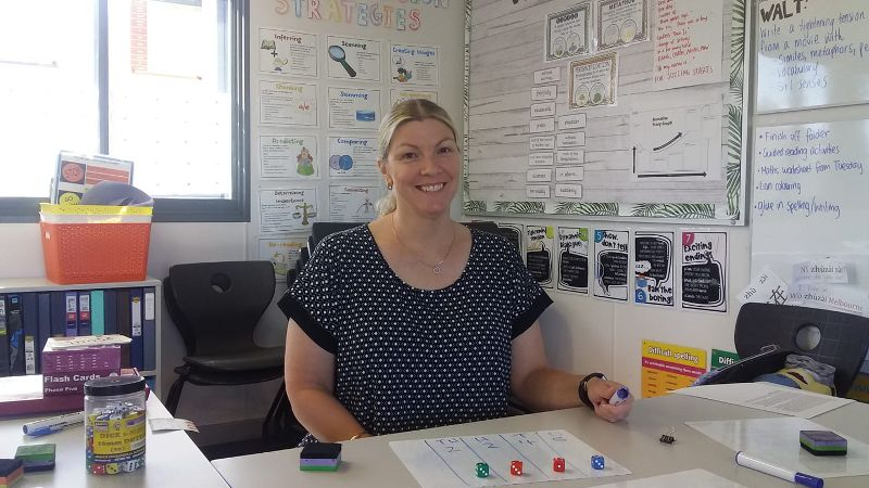 Education assistant shown finishing her placement in a classroom.