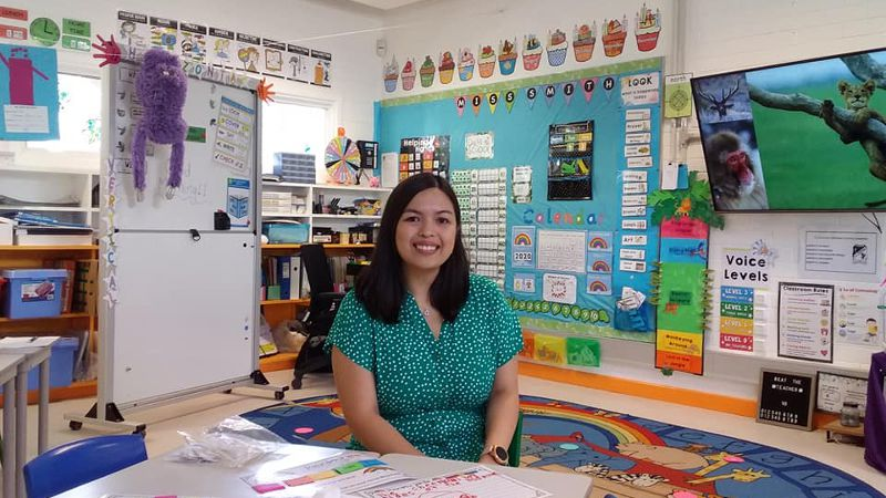 Teacher aide working in a classroom setting during work-placement.