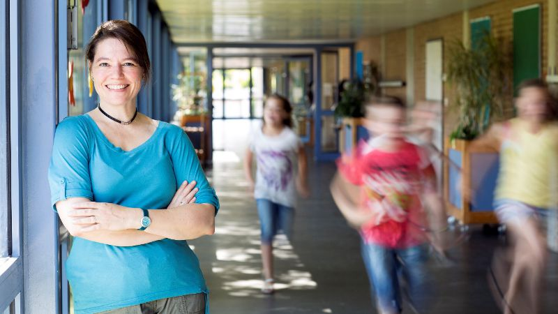 Teacher assistant working in a busy school environment.